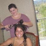 the bride to be getting her hair curled