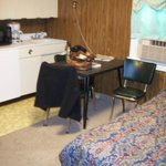 Kitchen area in main room by double bed