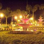 Fountain leading down to the pool and beach at night