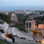 Plovdiv's Amphitheatre and the city behind. Beggening of the night. In Septembre.
