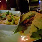 Buffalo fried chicken sandwich with Caesar salad