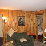 living room, with bedroom on either side of pic