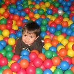 Happy guy in one of the two huge ball pits