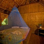 Guests stay in traditional Melanesian leaf houses