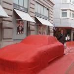 The red Porsche