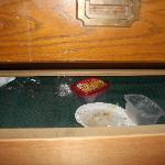 garbadge on the floor inside the drawer.