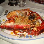 A large baked lobster with clams and mussels with linguine