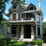 Take a walking tour around downtown Mobile, there are lots of beautiful Victorians like this one