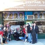 Tour guide and group in front of Harlem Heritage Tour office