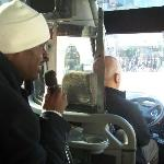 Tour guide on Bus showing us many sites