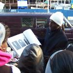 Tour guide sharing pictures of Harlem from local vendor