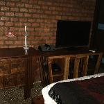 writing desk and chair, iPod dock, TV and console with more space for your stuff