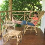 Ammu puts up her feet in the balcony of our cottage