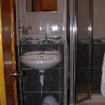 Tiny bathroom, Toliet was just behind the door.