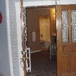 View from the front door.. no bathroom door so no one to come or go when someone is in the showe