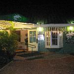 Front view of CJ's at night.
