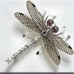 a dragonfly pin that Ingrid Blackert made, for sale at the gallery