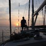 David at sunset on the sailboat.