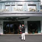 IN FRONT OF ENTRANCE OF CARLTON HOTEL IN ST MORITZ