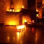candles in the foreground, fireplace in the background