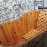 Wooden bathtub part of the Queen's Room bathroom