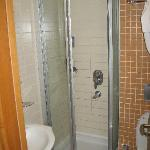 The tight entry to the extremely small shower