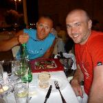 My husband with our other friend (when they saw how I'm enjoying the carpacio, thay had to order
