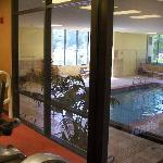 indoor pool with hot tub and fitness center
