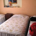 Room 3, has three single bed and is bright and clean.