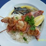 Entré, prawn on skewers wrapped with bacon