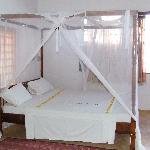 The bed in the top suite.