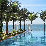 Infinity pool opens to the sea