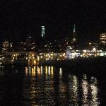 Nighttime view of Fisherman's Wharf and Coit Tower from Forbes Island