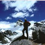 Peter standing below the summit under the storm