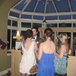 Bride and Groom after dinner relaxing with friends by the bar