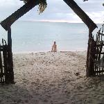 wy wife on the beach beyond the gate from the courtyard