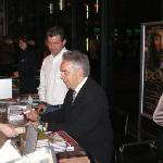 Howard signing CDs and posters.