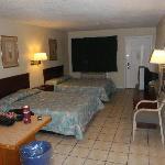 Room with two queen beds looking towards door