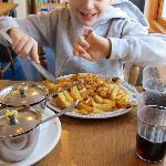 Not normally a food enthusiast, the junior tucks in