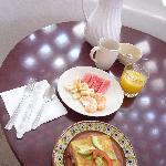Tasty full breakfast:French toast with cheese & ham, freshly squeezed orange juice, fresh fruits