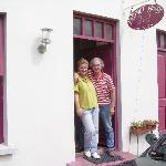Ronnie and Sandra Carthy in front of Fastnet House