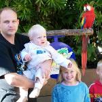 my family with one of the macaws you can have your photo taken with