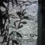 Shadow on the courtyard wall
