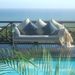 Relax on the pool deck, overlooking the ocean