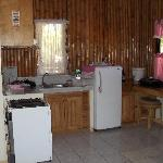 Kitchen area & refrigerator.