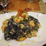 Fettucine with squid ink in creamy seafood sauce