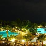 Nighttime view from balcony over pool out to sea