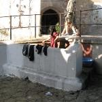 Tangier, Morocco - woman washing clothes