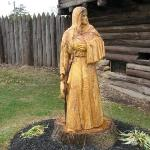Wood carving of Indian maiden.