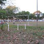 The town plaza revolves around the soccer field.  You can see the ocean through the trees.